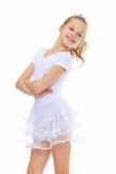 Dziewczyny gimnastyczka w białym tracksuit fotografia royalty free