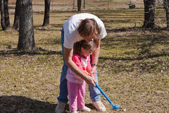 dziewczyny golfowej lekci s potomstwa Zdjęcia Royalty Free