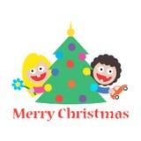 Dziewczyny i chłopiec wesoło bożych narodzeń prezenta drzewo Fotografia Stock