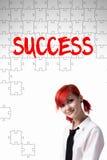 Dziewczyny i inskrypci sukces budujący łamigłówka obrazy stock
