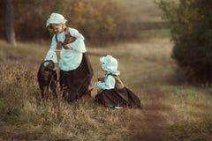 dziewczyny i kózki Obrazy Royalty Free