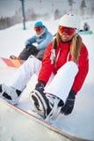 Dziewczyny jazda na snowboardzie Zdjęcie Royalty Free