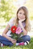 dziewczyny kwiat młode gospodarstwa Zdjęcia Stock