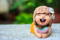 Dziewczyny lali gliniany ogród zdjęcie royalty free