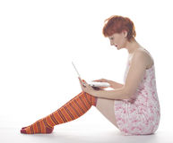 dziewczyny laptopu czerwony skarpet lampas Fotografia Royalty Free