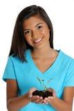 dziewczyny mienia roślina nastoletnia Obrazy Royalty Free