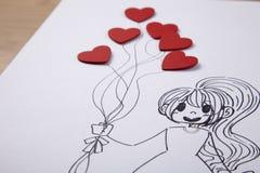 Dziewczyny mienia serca kształtny ballon Zdjęcia Stock