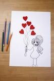 Dziewczyny mienia serca kształtny ballon Fotografia Stock