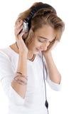 dziewczyny nastoletni słuchający muzyczny Obrazy Royalty Free