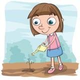 Dziewczyny podlewania roślina Fotografia Stock
