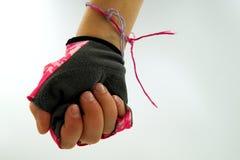 Dziewczyny ręka robi pięści jest ubranym rowerową rękawiczkę zdjęcie royalty free