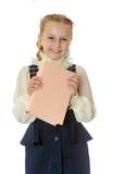 Dziewczyny szkoła w czarnej książce w jego i sukni ręki Zdjęcia Royalty Free