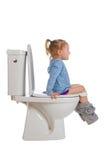 dziewczyny toaleta mała siedząca Fotografia Royalty Free