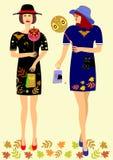 Dziewczyny w sukni z symbolami Halloweenowymi royalty ilustracja