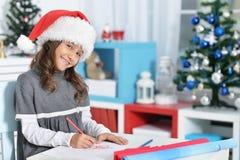 Dziewczyny writing list Zdjęcie Royalty Free