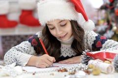 Dziewczyny writing list Obrazy Stock