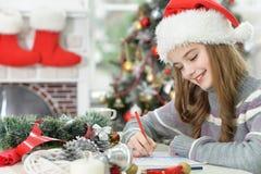 Dziewczyny writing list dla Santa Zdjęcie Stock