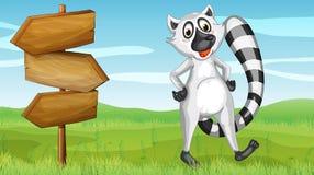 Dzikie zwierzę i drewniany signboard Fotografia Royalty Free