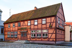 Dziugas surio namai (eng. Dziugas cheese house) facade. Half-timbered house in the old town of Klaipeda city. Lithuania Royalty Free Stock Photo