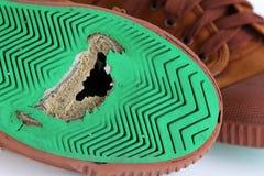 Dziura na brezentowych butach Zdjęcie Stock