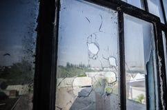 dziura po kuli w okno Obraz Royalty Free