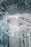 Dziura w łamającym zniweczonym ochrony szkle, asekuracyjny ochrony przestępstwa pojęcie obrazy stock