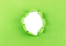 Dziura w zielonym papierze Fotografia Royalty Free