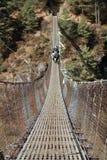 Dzo Crossing. A steel suspension bridge Stock Photos