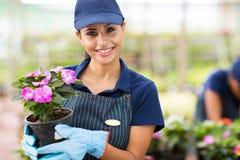 Żeńscy ogrodniczka kwiaty Obrazy Royalty Free