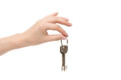 Żeńscy ręka chwytów klucze na białym tle Obraz Royalty Free