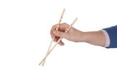 Żeńscy ręki mienia chopsticks obraz stock