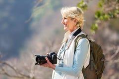 Żeńska fotograf kamera Fotografia Stock