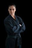 Żeńska karate gracza pozycja z rękami krzyżować obraz royalty free