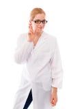 Żeńska naukowiec pozycja z jej palcami krzyżującymi zdjęcia royalty free