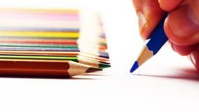 Żeńska ręka bierze barwionego ołówek i rysunek na białym papierze Obraz Royalty Free
