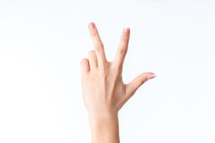 Żeńska ręka pokazuje gest z trzy palcami Fotografia Stock