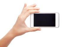 Żeńska ręka trzyma nowożytnego smartphone zdjęcie stock