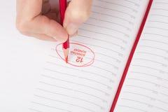 Żeńska ręka z ołówkiem obrazy stock