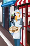 Żeńska właściciel sklepu pozycja przed jej sklepem Obrazy Royalty Free