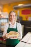 Żeńska wlaściciel sklepu porci kanapka Zdjęcia Royalty Free