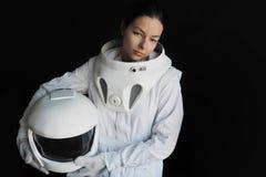 Żeński astronauta na czarnym tle Fantastyczny astronautyczny kostium Eksploracja kosmos Zdjęcia Stock