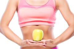 Żeński foremny ciało i zielony jabłko odizolowywający na białym plecy zdjęcia stock