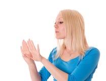 Żeński patrzejący jej gwoździe z manicure'em. Fotografia Royalty Free