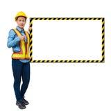 Żeński pracownik z ochrony wyposażeniem, pozuje stronę duży whit Obrazy Stock