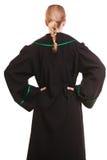 Żeński prawnik jest ubranym klasycznego połysku czerni zieleni togi plecy widok zdjęcie stock