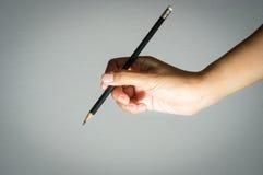 Żeński ręki writing z ołówkiem Zdjęcie Royalty Free