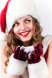 Żeński Santa cieszyć się śnieżni boże narodzenia Zdjęcia Stock