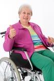 Żeński senior w wózku inwalidzkim Zdjęcia Royalty Free