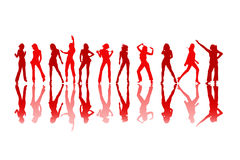 Żeńskie dancingowe czerwone sylwetki Obraz Royalty Free