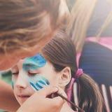 Żeńskiego dziecka twarzy obraz, robi motyla procesowi Obraz Royalty Free